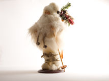 Father Christmas figurine. In white hat,and costume Royalty Free Stock Image