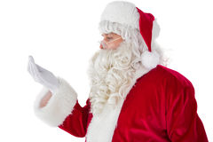 Father christmas with hand out Stock Images