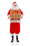 Father Christmas holding a gift wrapped present  Royalty Free Stock Images