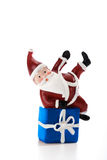 Father Christmas lying on present  on white Royalty Free Stock Photo