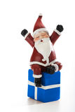 Father Christmas lying on present  on white Royalty Free Stock Photography