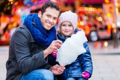Father on Christmas market buying sweets for child Stock Photos