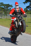 Father Christmas on motorcycle Royalty Free Stock Photos