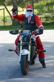 Father Christmas on motorcycle Stock Photo