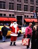 Father Christmas, New York. Father Christmas along 5th Avenue at Christmas with Saks to the rear, New York, USA stock photography