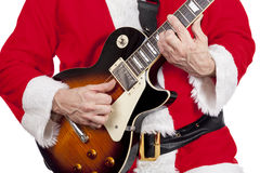 Father christmas playing an electric guitar Stock Images