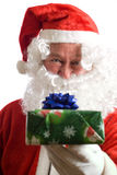 Father Christmas with present Royalty Free Stock Image