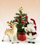 Father Christmas and reindeer. Rudolf reindeer and Father Christmas with christmas tree Royalty Free Stock Photography
