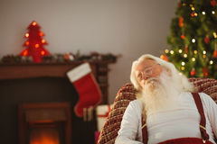 Father christmas resting on the armchair Stock Photography
