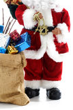 Father Christmas with sack full of gifts Stock Photo