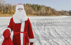 Father Christmas, Santa Claus is in the woods with a bag of gifts. Stock Photo