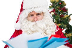 Father christmas showing many letters Royalty Free Stock Image