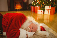 Father christmas sleeping on the rug Royalty Free Stock Image