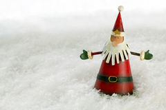 Father Christmas in Snow. Father Christmas decoration against a snow backdrop with copy space Royalty Free Stock Photography