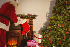 Father christmas stocking gifts at christmas eve Stock Images