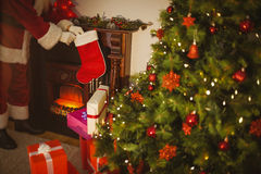Father christmas stocking gifts at christmas eve Royalty Free Stock Photography