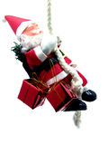 Father Christmas suspended at a rope Royalty Free Stock Photo