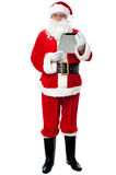 Father Christmas using new tablet device Stock Images
