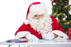 Father christmas writing letters Royalty Free Stock Image