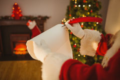 Father christmas writing with a quill Royalty Free Stock Photography