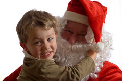 Father Christmas and young boy Royalty Free Stock Photo