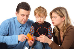 Father cleans to son an orange Royalty Free Stock Photography