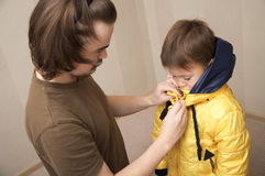 Father clothing son Royalty Free Stock Photo