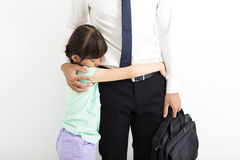 Father comforting his crying daughter. Before go to work Stock Image