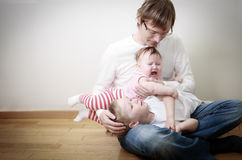 Father comforting his crying daughter and son Stock Photo