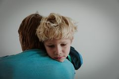 Father comforting sad child, parenting, sorrow concept royalty free stock photo