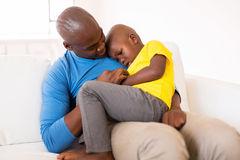 Father comforting son Stock Images