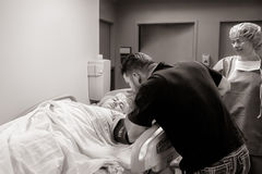 Father Comforts Daughter Before C-Section royalty free stock image