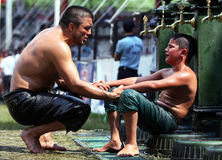 A father comforts his son after he lost his bout at the Kirkpinar Turkish Oil Wrestling Festival at Edirne in Turkey. Stock Images