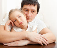 Father comforts a sad girl Stock Photo