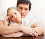 Father comforts a sad girl Stock Photo