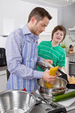 Father cooking with his son in the kitchen - family life Stock Photo