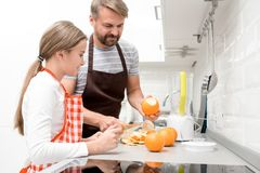 Father Cooking with Teenage Girl stock images