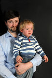 Father and crabby boy Stock Photos
