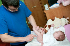 Father creaming baby Royalty Free Stock Photo