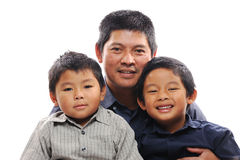 Father Cuddles Sons. Asian father cuddles sons looking happy Stock Images