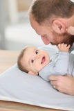 Father cuddling his smiling baby Stock Photo