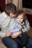 Father cuddling son Stock Photography