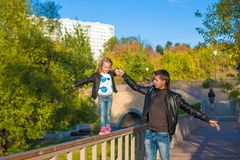 Father and cute daughter in autumn park outdoors Stock Images