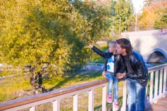 Father and cute daughter in autumn park outdoors Royalty Free Stock Photo