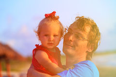 Father and cute little daughter on summer beach Stock Images