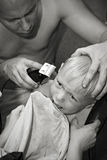 Father cutting hair son. Everyday life Royalty Free Stock Photography