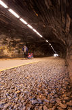 Father cycling through a tunnel with his child Stock Image