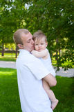 Father dad parent holding baby boy Stock Images