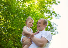 Father dad parent holding baby boy Royalty Free Stock Photo