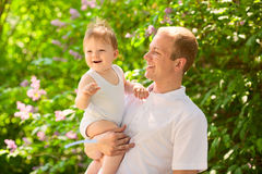 Father dad parent holding baby boy Royalty Free Stock Images